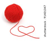 Thread ball with heart isolated on white background - stock photo