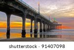 sun setting by the manhattan beach pier,california. this is an HDR image composed of 3 shots processed with photomatix pro 4.
