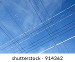 birds soaring above hydro wires ... | Shutterstock . vector #914362