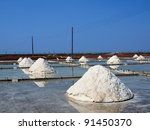 Salt fields with piled up sea salt on the coast of Taiwan - stock photo