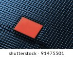blue mesh with red plate - stock photo