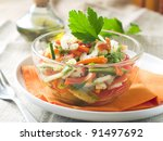 A bowl of fresh vegetables salad, selective focus - stock photo