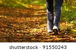 Woman Walking Cross Country An...