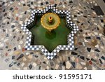 Aerial view of star shaped mosaic water fountain in courtyard in Fez, Morocco. - stock photo