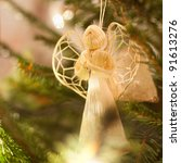 Figure of an angel decorating a Christmas tree - stock photo