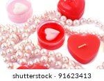 Heart shape red candles and necklace isolated on white background. - stock photo