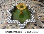 Closeup of a tiled fountain of geometric design in a courtyard in Morocco. - stock photo