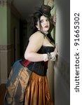 Beautiful sensual steampunk woman wearing vintage dress - stock photo