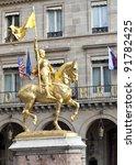 Golden statue of Saint Joan of Arc in Paris - stock photo