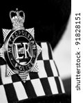 Metropolitan police cap badge mono - stock photo