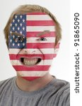 High key portrait of an angry man whose face is painted in colors of american flag - stock photo