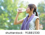 woman drink water after sport | Shutterstock . vector #91881530