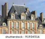 Beautiful buildings of Place des Vosges, square in Paris, France, third arrondissement near Le Marais. - stock photo