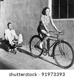 Woman On A Bicycle Pulling A...