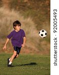 boy playing with soccer ball in ... | Shutterstock . vector #92005493