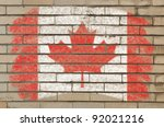 Chalky  canadian flag painted with color chalk on grunge old brick wall - stock photo