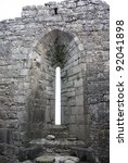 Ancient slit of a church in the Aran Islands - stock photo