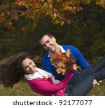 Young man carrying his girlfriend in his arms - stock photo