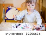 an adorable baby girl painting | Shutterstock . vector #92206636