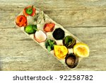Overhead view of compost fruit and vegetables in egg carton, on rustic wooden background - stock photo