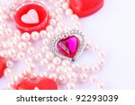 Heart shape red candles, stone and  necklace  on grey background. - stock photo