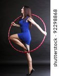 Beautiful woman in a sport wear. Dance hoop gym exercises - stock photo
