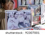 NYAUNGU-NOVEMBER 17:Selling photo's of Aung San Suu Kyi. With elections and the release of Suu Kyi, the brutal military regime seems to be loosening its grip. November 17  2011 Nyaungu, Myanmar - stock photo