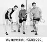 three men playing squash | Shutterstock . vector #92359030