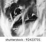 Two Fire Fighters Rescuing A...