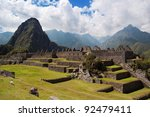 Three Doorway group of ruins width Wayna Picchu in background, Machu Picchu. - stock photo