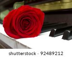 single red rose on the piano... | Shutterstock . vector #92489212