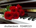 rose bouquet on a piano keyboard | Shutterstock . vector #92489215