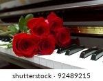 rose bouquet on a piano keyboard   Shutterstock . vector #92489215