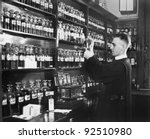Man in a pharmacy mixing medicine - stock photo