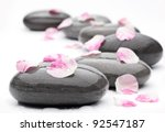 Spa Stones With Rose Petals On...