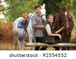Stock photo a couple on a horse ride 92554552