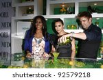 WEST HOLLYWOOD, CA - MAY 10: LaLa Vasquez, Kim Kardashian, Scott Ford at the Midori Melon Liqueur Trunk Show at Trousdale on May 10, 2011 in West Hollywood, California - stock photo