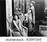woman sitting in an armchair... | Shutterstock . vector #92597245
