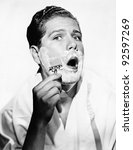 portrait of a young man shaving | Shutterstock . vector #92597269