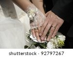 Just married couple hands with flowers. - stock photo