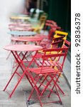 tables and chairs in the street - stock photo