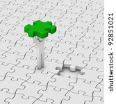 man with last jigsaw piece for puzzle pavement - stock photo