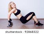 beautiful woman doing fitness... | Shutterstock . vector #92868322