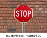 stop sign up against a brick ... | Shutterstock . vector #92889520