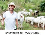 Male Rancher In A Farm With...