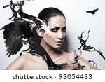 passion brunette woman with black splash and crows - stock photo