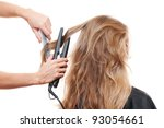hairdresser straightening hair... | Shutterstock . vector #93054661