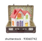New colorful house in old suitcase with clipping path - stock photo