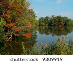 A peaceful Autumn lake scene with nice colors and reflections. - stock photo