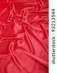 Beautiful red silk cloth is the vertical texture - stock photo